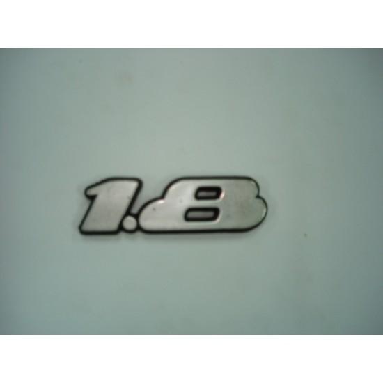 Emblema 1.8 Plástico
