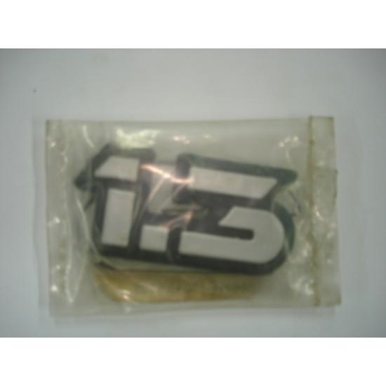 Emblema 1.3 Plástico